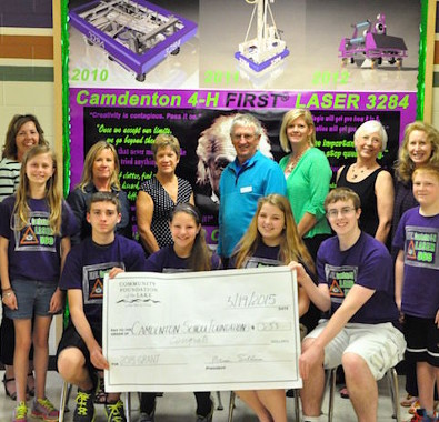 Members of Camdenton's FIRST teams accept a grant from a local community organization.