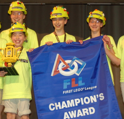"TJ Evarts (center) and his FIRST LEGO League team, ""The Inventioneers"""