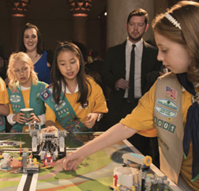 Members of the Girl Scouts of Greater New York demonstrate their FIRST LEGO League robot.
