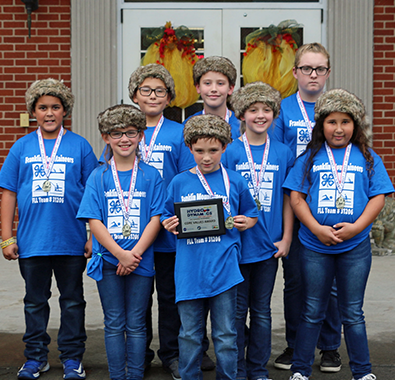 "FIRST LEGO League team ""Franklin Mountaineers"" displays the Core Values award"