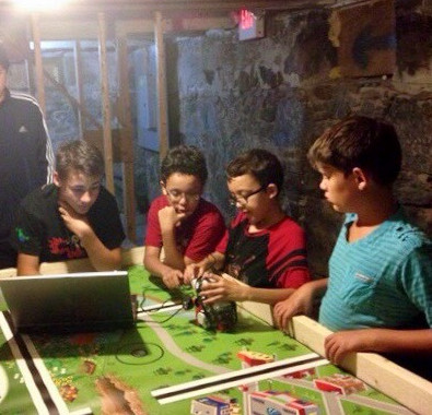 FIRST LEGO League team working on robot