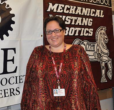 STEM teacher and robotics coach Monique Dituri poses in her classroom in Clifton, NJ.