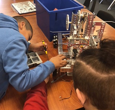 Students at Boys and Girls Haven in Louisville, Kentucky, build a robot for FIRST Tech Challenge.