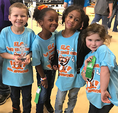 Students from St. Martinville, Louisiana, celebrate their achievements at a FIRST LEGO League Jr. expo.
