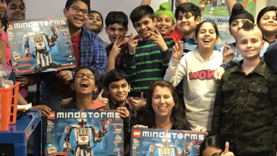 Group of kids with LEGO MINDSTORMS robotics kit