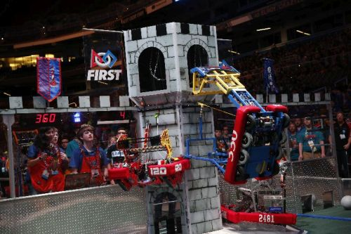 Figure 1. Robots built by high-school students on FIRST Robotics Competition teams climb a tower to earn points as part of a theme-based floor game. (Source: Adriana M. Groisman, courtesy of FIRST.)