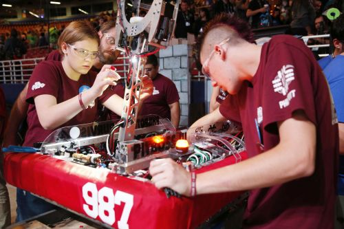 Figure 4. FIRST Robotics Competition participants, ages 14–18, have six weeks to build a 120-pound robot for a theme-based game that changes each year. (Source: Adriana M. Groisman, courtesy of FIRST.)