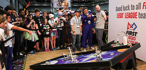 FIRST and LEGO Education unveiled the space-themed field mat for the 2018-2019 FIRST LEGO League season, INTO ORBIT, at FIRST Championship.