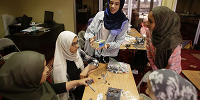 FemSTEM students work on the team robot for FIRST LEGO League.