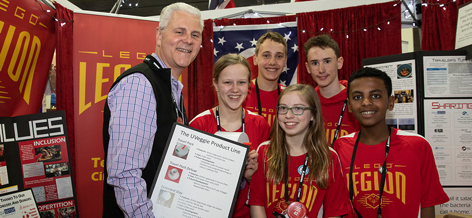 "FIRST President Donald E. Bossi meets with FIRST LEGO League team ""LEGO Legion"" at FIRST Championship Detroit."