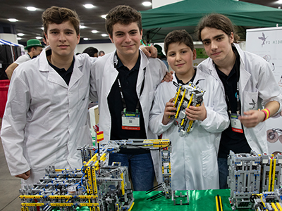 "FIRST LEGO League team ""FSINGENIUM"" pose in the pits at FIRST Championship Detroit."