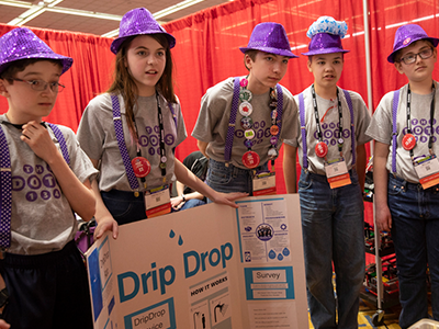 "FIRST LEGO League team ""The Dots"" present to judges at FIRST Championship Detroit"