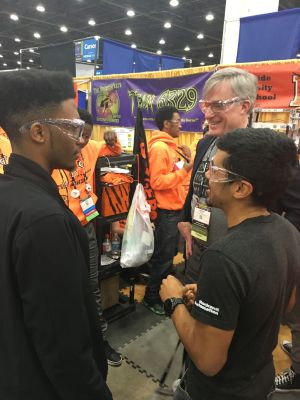 Javion speaks with Rockwell Automation representatives at the FIRST Championship.