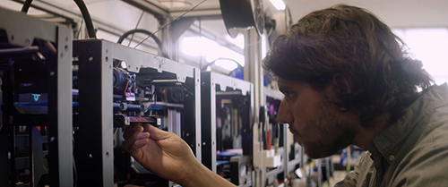 Jonathan Schwartz works on a 3-D printer at Voodoo.