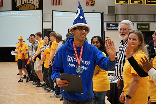 Ishaan Oberoi accepts the Dean's List Finalist award at the 2019 FIRST Tech Challenge Maryland State Championship.