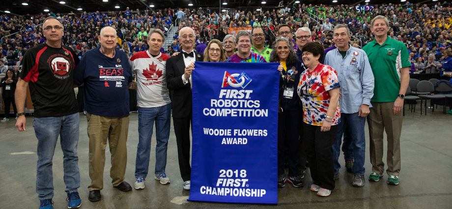 Gail Drake (five from left), recipient of the 2018 Woodie Flowers Award for outstanding mentorship, with Woodie Flowers (four from left) and past winners at the 2018 FIRST Championship.