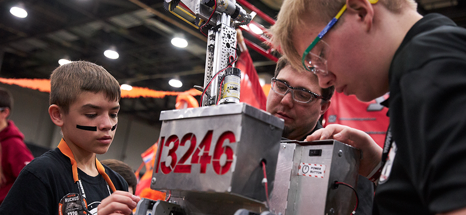 Students work on their robot in the FIRST Tech Challenge pits at FIRST Championship.