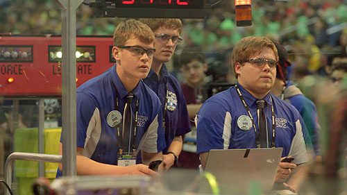 Robot drivers from Team 5172 compete during a match at FIRST Championship.