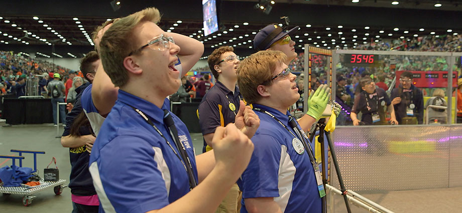 "Students from FIRST Robotics Competition Team ""Gator Robotics"" – based in a small Minnesota near the Canadian border – celebrate during a robotics match at the 2018 FIRST Championship in Detroit."