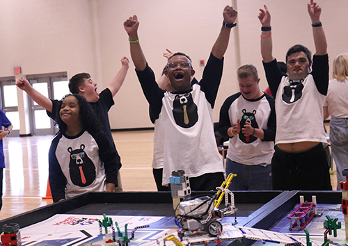"""The Dancing Bears"" cheer after successfully completing a mission during the Robot Challenge."