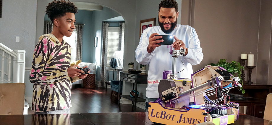 "Jack (Miles Brown) demonstrates his robot, nicknamed ""LeBot James,"" to his dad, Dre (Anthony Anderson) on ""black-ish."""