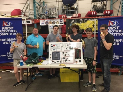 FIRST Robotics Competition Team 1189 with their Control System Board and bananas