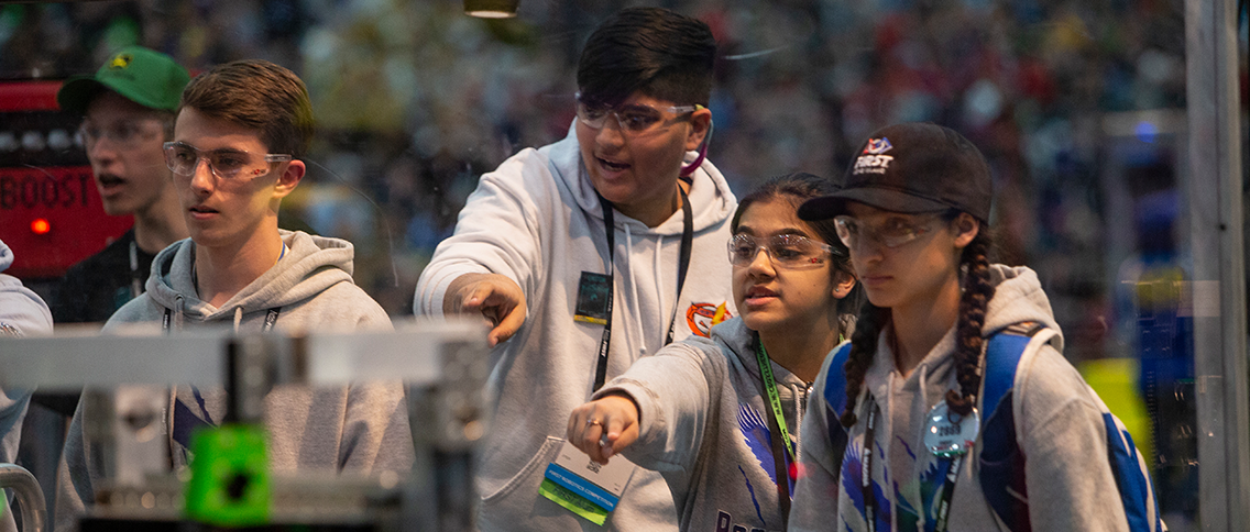 High school students at FIRST robotics event