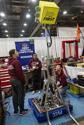 Members of the Mustangs test their robot in the team's pit at the 2018 FIRST Championship in Houston.