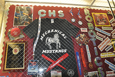 A display case devoted to the Mechanical Mustangs robotics team is prominent in Clifton High School.