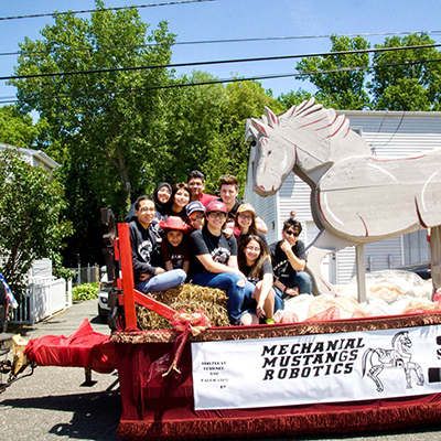 The Mechanical Mustangs participate in the Clifton Bicentennial Parade on their team-built float.