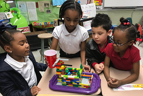 Students at the Early Learning Center in St. Martinville, Louisiana, work on their FIRST LEGO League Jr. model.